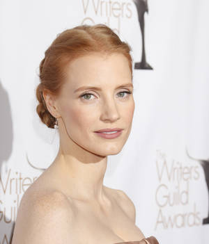 Photo - Jessica Chastain attends the 2013 Writers Guild Awards at the JW Marriott on Sunday, Feb. 17., 2013 in Los Angeles. (Photo by Todd Williamson/Invision/AP)