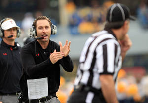 Photo - FILE - In this Oct. 19, 2013, file photo, Texas Tech coach Kliff Kingsbury yells for a timeout to an official during an NCAA college football game against West Virginia in Morgantown, W.Va. First-year coach Kingsbury and Texas Tech will play against Oklahoma on Saturday, Oct. 26. (AP Photo/Chris Jackson, File)