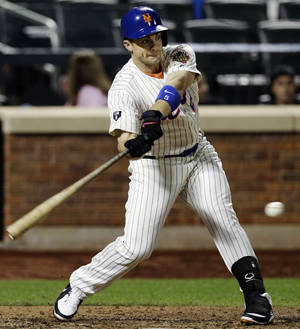 Photo -   New York Mets' David Wright hits a seventh-inning, two-run single during their baseball game against the Pittsburgh Pirates at Citi Field in New York, Tuesday, Sept. 25, 2012. (AP Photo/Kathy Willens)