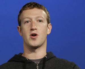 Photo - FILE - In this Thursday, March 20, 2013 file photo, Facebook CEO Mark Zuckerberg speaks at Facebook headquarters in Menlo Park, Calif. Zuckerberg reaped a $3.3 billion gain last year by exercising stock options in the social networking company that he founded in a Harvard University dorm room. (AP Photo/Jeff Chiu, File)