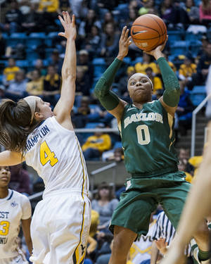 Photo - Baylor's Odyssey Sims shoots as West Virginia's Brooke Hampton(4) defends during the first half of an NCAA college basketball game Wednesday, Jan. 8, 2014, in Morgantown, W.Va. (AP Photo/Andrew Ferguson)