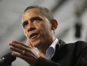 photo -   President Barack Obama gestures as he speaks at Springfield High School during a campaign event, Friday, Nov. 2, 2012, in Springfield, Ohio. (AP Photo/Pablo Martinez Monsivais)