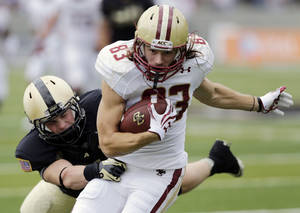 Photo - Boston College wide receiver Alex Amidon (83) breaks away from Army defensive back Ty Shrader (4) after a reception during the first half of an NCAA college football game Saturday, Oct. 6, 2012, in in West Point, N.Y. (AP Photo/Mike Groll)