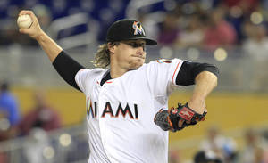 Photo - Miami Marlins starting pitcher Tom Koehler throws against the Atlanta Braves in the first inning during their baseball game in Miami, Friday, May 30, 2014. (AP Photo/Joe Skipper)