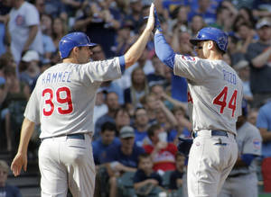 Photo - Chicago Cubs' Anthony Rizzo, right, is congratulated by Chicago Cubs' Jason Hammel, left, after hitting a two-run home run against the Milwaukee Brewers during the sixth inning of a baseball game Saturday, May 31, 2014, in Milwaukee. (AP Photo/Darren Hauck)