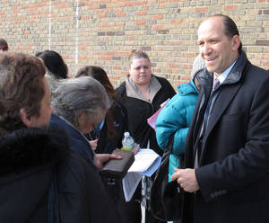 Photo - Howard Lutnik, CEO of the financial services firm Cantor Fitzgerald, speaks to residents waiting in line for $1,000 payments being given to victims of Superstorm Sandy in Long Beach, N.Y., on Friday, March 1, 2013. Cantor Fitzgerald, who lost 658 employees when the World Trade Center was attacked on Sept. 11, 2001, established a relief fund to help surviving families. Lutnik said the fund is now used to help victims of other tragedies, and the firm is distributing $10 million to Sandy victims throughout the region. (AP Photo/Frank Eltman)