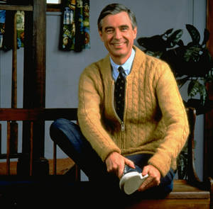 Photo - Fred Rogers poses on the Pittsburgh set of his television show Mister Rogers' Neighborhood, in this 1996 publicity photo. <strong></strong>