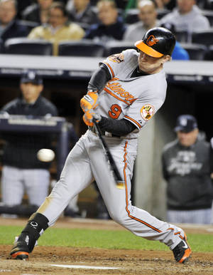 Photo -   Baltimore Orioles' Nate McLouth hits a home run during the fifth inning of Game 4 of the American League division baseball series against the New York Yankees, Thursday, Oct. 11, 2012, in New York. (AP Photo/Bill Kostroun)