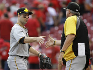 Photo - Pittsburgh Pirates second baseman Neil Walker, left, is congratulated by manager Clint Hurdle after they defeated the Cincinnati Reds 8-3 in a baseball game on Saturday, Sept. 28, 2013, in Cincinnati. Walker hit two home runs in the game. (AP Photo/Al Behrman)