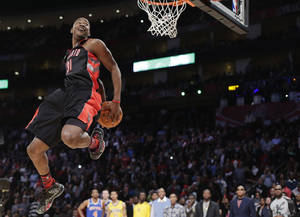 Photo - Terrence Ross of the Toronto Raptors goes up during the dunk contest at NBA basketball All-Star Saturday Night, Feb. 16, 2013, in Houston. (AP Photo/Eric Gay)