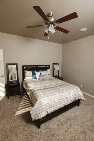 Photo - Master bedroom at 8400 NW 141 Circle, built by Timbercraft Homes in the Pleasant Grove Addition, in Oklahoma city Monday, Oct. 7, 2013. The home is 2,150 square feet built from the Willow Creek house plan. Photo by Paul B. Southerland, The Oklahoman