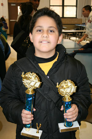 Photo - Jorge Toscano, 11, holds his awards after Jackson Middle School's Science Fair. Toscano won first place out of 600 participants. Photo provided. <strong></strong>
