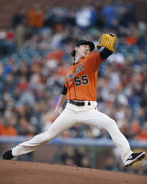 Photo - San Francisco Giants starting pitcher Tim Lincecum throws against the Minnesota Twins in the first inning of a baseball game Friday, May 23, 2014, in San Francisco. (AP Photo/Tony Avelar)