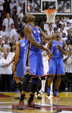 Photo - Oklahoma City's Kevin Durant reacts after missing a shot in the final seconds during Game 4 of the NBA Finals between the Oklahoma City Thunder and the Miami Heat at American Airlines Arena, Tuesday, June 19, 2012. Oklahoma City lost 104-98.  Photo by Bryan Terry, The Oklahoman