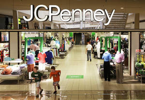 photo - Shoppers walk in a J.C. Penney store in Plano, Texas.   AP Photo