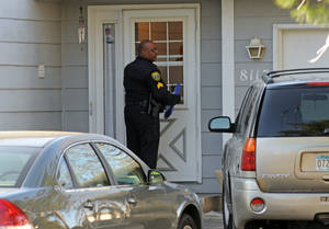 Photo -   Police investigate the scene where three people were shot and killed at an in-home day care in Brooklyn Park, Minn., on Monday, April 9, 2012. No arrests were immediately made. (AP Photo/The Star Tribune, Richard Sennott) MANDATORY CREDIT; ST. PAUL PIONEER PRESS OUT; MAGS OUT; TWIN CITIES TV OUT