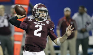 Photo - Texas A&M quarterback Johnny Manziel (2) looks for a receiver in the second half of the Chick-fil-A Bowl NCAA college football game against Duke Tuesday, Dec. 31, 2013, in Atlanta. (AP Photo/John Bazemore)