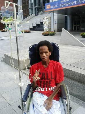 Photo - Sean Jones leaves the hospital in South Korea after months of treatment for encephalitis. PHOTO PROVIDED <strong>PROVIDED</strong>