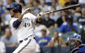 Photo - Milwaukee Brewers' Yovani Gallardo watches his double against the New York Mets during the fourth inning of a baseball game on Saturday, July 6, 2013, in Milwaukee. (AP Photo/Jeffrey Phelps)