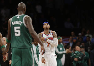 Photo - New York Knicks forward Carmelo Anthony (7) reacts as Boston Celtics center Kevin Garnett (5) returns to the bench at the end of Game 5 of their first-round NBA basketball playoff series at Madison Square Garden in New York, Wednesday, May 1, 2013. The Celtics won 92-86. (AP Photo/Kathy Willens)