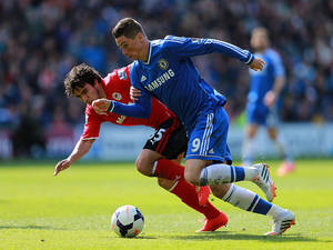 Photo - Chelsea's Fernando Torres, right, and Cardiff City's Fabio Da Silva race for the ball during their English Premier League soccer match at the Cardiff City Stadium, Cardiff, Wales, Sunday May 11, 2014. (AP Photo / David Davies, PA) UNITED KINGDOM OUT - NO SALES - NO ARCHIVES