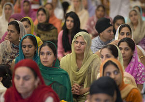 Photo -   People attend a prayer service at the Sikh Temple of Wisconsin in Oak Creek, Wis., Sunday, Aug. 12, 2012. More than 100 people gathered for the first Sunday prayer service since a white supremacist shot and killed six people there before fatally shooting himself. (AP Photo/Jeffrey Phelps)