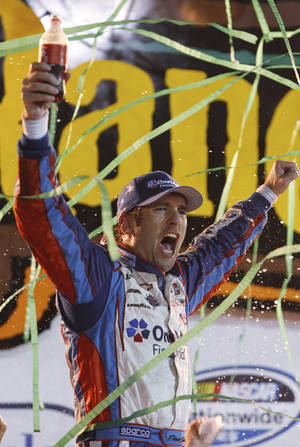 Photo -   Elliott Sadler celebrates in victory lane after winning the NASCAR Nationwide Series auto race at Iowa Speedway in Newton, Iowa, Saturday, Aug. 4, 2012. (AP Photo/Brian Ray)