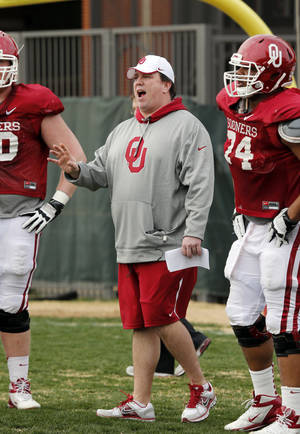 Photo - New offensive line coach in Bill Bedenbaugh beefed up the offensive line over the offseason Photo by Steve Sisney, The Oklahoman