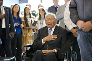 Photo -  Edmond Harjo, 96, of the Seminole Nation of Oklahoma, places his hand over his heart as the American flag is presented during a Congressional Gold Medal ceremony Nov. 20 on Capitol Hill in Washington. AP file photo  <strong>J. Scott Applewhite -   </strong>