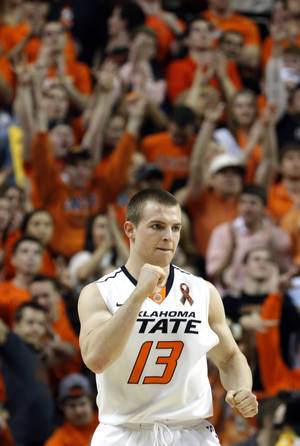 Photo - Oklahoma State's Phil Forte (13) celebrates a score during the Bedlam men's college basketball game between the Oklahoma State University Cowboys and the University of Oklahoma Sooners at Gallagher-Iba Arena in Stillwater, Okla., Saturday, Feb. 16, 2013. Photo by Sarah Phipps, The Oklahoman