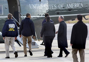 photo - <p>President Barack Obama, second from left, accompanied by, from left, Housing and Urban Development Secretary Shaun Donovan, New York Gov. Andrew Cuomo, Homeland Security Secretary Janet Napolitano, and New York City Mayor Michael Bloomberg, walks towards the Marine One helicopter at JFK International Airport in New York, Thursday, Nov. 15, 2012, before taking a aerial tour of damage along the New York coastline to view damage from Superstorm Sandy. (AP Photo/Craig Ruttle)</p>