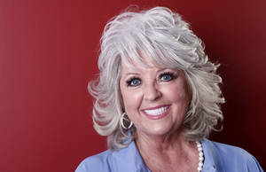 Photo -   FILE - In this Tuesday, Jan. 17, 2012 photo, celebrity chef Paula Deen poses for a portrait in New York. A month after being widely criticized for revealing she has diabetes, as well as a lucrative endorsement deal for a drug to treat it, Paula Deen says she's ready to show a lighter side to her famously fatty Southern-style cooking. (AP Photo/Carlo Allegri)