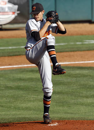Photo - Oklahoma State's Andrew Heaney throws a pitch during the Big 12 baseball tournament game between Oklahoma State University and the University of Oklahoma at the Chickasaw Bricktown Ballpark in Oklahoma City,  Wednesday, May 23, 2012. Photo by Sarah Phipps, The Oklahoman.