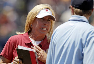 Photo - OU / COLLEGE SOFTBALL: Oklahoma coach Patty Gasso argues with an umpire during a Women's College World Series softball game between the University of Oklahoma and Missouri at ASA Hall of Fame Stadium in Oklahoma City, Saturday, June 4, 2011.  Missouri won, 4-1. Photo by Bryan Terry, The Oklahoman ORG XMIT: KOD