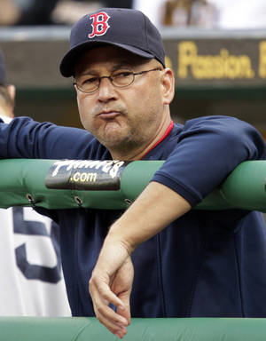 Photo -   FILE - In this June 25, 2011, file photo, Boston Red Sox manager Terry Francona stands in the dugout during a 6-4 loss to the Pittsburgh Pirates in an interleague baseball game in Pittsburgh. A person familiar with the decision says the Cleveland Indians on Saturday, Oct. 6, 2012, have chosen Francona to be their next manager and are working with him on a contract. (AP Photo/Gene J. Puskar, File)