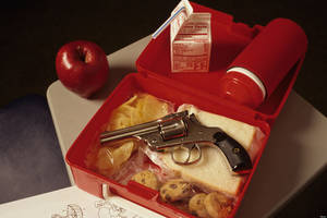 Photo - ATCNG0 Hand gun in opened lunch pail at school during lunch time showing the problem with school violence