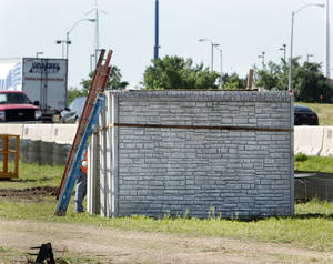 Photo - Precast fence panels are being used to build a sound barrier along Interstate 35 to buffer residences from noise that back up to the highway in Norman.