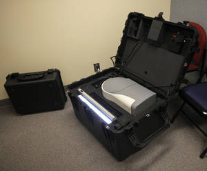 photo - A digital X-ray machine, seen here, uses X-rays to generate a negative image of the body and, potentially, the bomb inside it. Photo by Garett Fisbeck, The Oklahoman