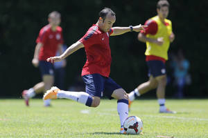 Photo - United States' Landon Donovan kicks the ball during a training session in Sao Paulo, Brazil, Wednesday, Jan. 22, 2014. The US national soccer team is on a training program in Sao Paulo preparing for the World Cup tournament, which gets underway on June 12.  (AP Photo/Nelson Antoine)