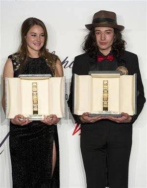 Photo - Actors Shailene Woodley, left and Ezra Miller, with their Chopard trophies, during the Chopard Trophy awards ceremony  at the 65th international film festival, in Cannes, southern France, Thursday, May 17, 2012. (AP Photo/Jonathan Short)