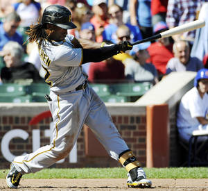 Photo -   Pittsburgh Pirates' Andrew McCutchen hits a home run against the Chicago Cubs during the third inning of a baseball game, Saturday, Sept. 15, 2012, in Chicago. (AP Photo/David Banks)