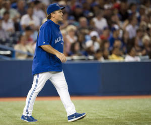 Photo - Toronto Blue Jays manager John Gibbons walks to the mound during the fifth inning of a baseball game against the New York Yankees in Toronto on Tuesday, Aug.  27, 2013. (AP Photo/The Canadian Press, Frank Gunn)