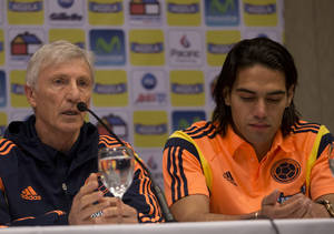 Photo - Colombia's national soccer team coach Jose Pekerman, left, announces the roster of players for the Brazil 2014 World Cup, with Colombian star Radamel Falcao Garcia sitting next to him, in Buenos Aires, Argentina, Monday, June 2, 2014. Falcao will not play in this World Cup as Pekerman did not include him in the final team roster. (AP Photo/Eduardo Di Baia))