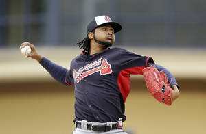 Photo - Atlanta Braves starting pitcher Ervin Santana throws during the third inning of a spring exhibition baseball game against the Detroit Tigers in Lakeland, Fla., Tuesday, March 25, 2014. (AP Photo/Carlos Osorio)