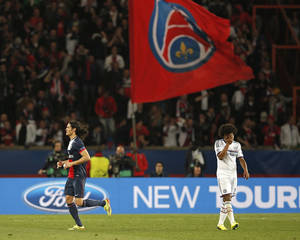 Photo - PSG's Edinson Cavani, left, celebrates as Chelsea's Willian reacts after David Luiz scored an own goal during the Champions League quarterfinal first leg soccer match between PSG and Chelsea, at the Parc des Princes stadium, in Paris, Wednesday, April 2, 2014. (AP Photo/Christophe Ena)