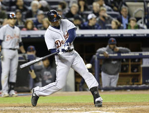 photo -   Detroit Tigers' Austin Jackson hits a triple in the sixth inning during Game 1 of the American League championship series against the New York Yankees on Saturday, Oct. 13, 2012, in New York. (AP Photo/Paul Sancya )