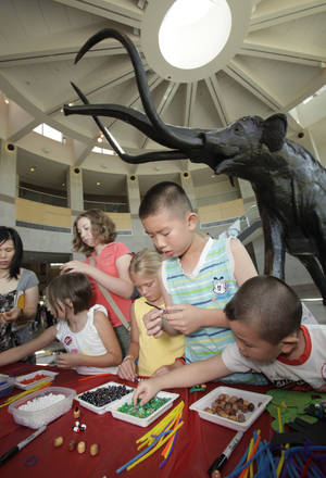 "photo - Children make ""book worms"" during Library Day at the Sam Noble Oklahoma Museum of Natural History in Norman. OKLAHOMAN ARCHIVE PHOTOs"