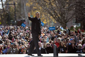 photo -   President Barack Obama waves to the cheering crowd after speaking at a campaign event in State Capitol Square, Sunday, Nov. 4, 2012, in Concord, N.H. (AP Photo/Carolyn Kaster)
