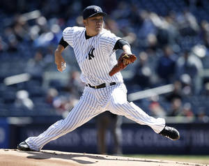 Photo - New York Yankees starting pitcher Masahiro Tanaka delivers in the first inning of the first game of an interleague baseball doubleheader against the Chicago Cubs at Yankee Stadium in New York, Wednesday, April 16, 2014.  (AP Photo/Kathy Willens)