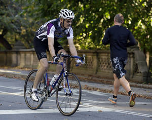 Photo - Starwood Hotels CEO Frits van Paasschen rides his bicycle in New York's Central Park,  Tuesday, Oct. 8, 2013. (AP Photo/Richard Drew)